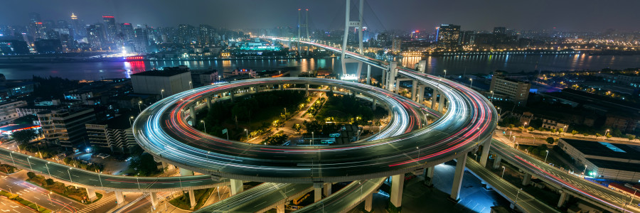 Aerial View of Busy Overpass in Shanghai at Night Light Trail of Shanghai Highway at Night China, Shanghai, Aerial View of Busy Intersection at Night, with Rush Hour Traffic.